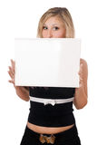 Surprised woman holding white board Stock Image
