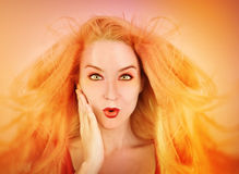 Surprised Woman with Hot Yellow Heat Royalty Free Stock Photos
