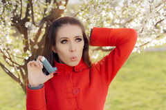 Surprised  Woman with Inhaler  in Spring Blooming Decor Royalty Free Stock Photos