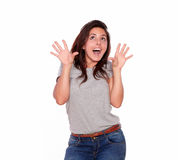 Surprised woman in jeans screaming with hands up Stock Image