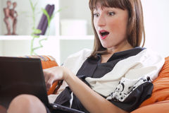 Surprised woman with laptop Royalty Free Stock Photo