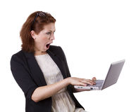 Surprised woman with laptop. Beautiful surprised woman with laptop, isolated on white Royalty Free Stock Image