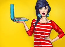 Surprised woman with laptop in the hand in comic style. royalty free illustration
