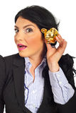 Surprised woman listening to piggy bank Royalty Free Stock Photo