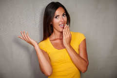 Surprised woman looking at camera with open mouth Royalty Free Stock Photo