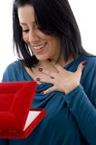 Surprised woman looking in jewellery box Stock Image