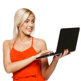 Surprised woman looking at laptop screen Royalty Free Stock Photo