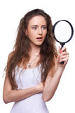 Surprised woman looking through magnifying glass Royalty Free Stock Photos