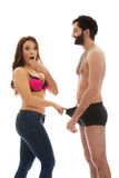 Surprised woman looking into man's panties. Royalty Free Stock Image