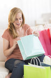 Surprised Woman Looking In Shopping Bag Stock Photos