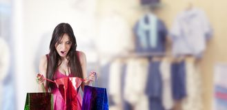 Surprised woman looking at shopping stock image