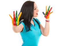 Surprised woman looking to hands in paints Royalty Free Stock Photography