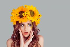 Surprised woman looking to side in floral crown stock images