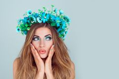 Surprised woman looking to side in floral crown royalty free stock images