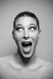 Surprised woman looking up. Portrait of beautiful surprised woman looking up Stock Photography