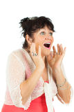 Surprised woman looking up at copy space on white. Royalty Free Stock Image