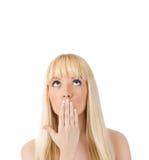 Surprised woman looking up at copyspac. Surprised young woman looking up at copyspace over white Stock Image