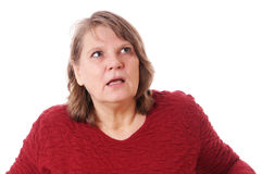 Surprised woman looking up. Shocked woman looking up, isolated on white stock photography