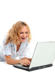 Surprised woman looks in the laptop royalty free stock images
