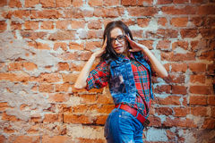 Surprised woman looks in modern glasses.Art processing and retou Royalty Free Stock Image