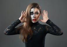 Surprised woman with makeup skeleton royalty free stock photos