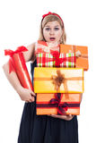 Surprised woman with many presents Stock Photo