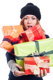 Surprised woman with many presents Royalty Free Stock Image