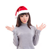 Surprised woman with X'mas santa hat Stock Photography