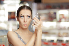 Surprised Woman with Mascara and Make-up mirror Stock Photos