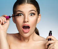 Surprised woman with Mascara Royalty Free Stock Images
