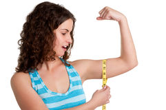 Surprised Woman measuring her Biceps. Isolated in a white background Stock Photography