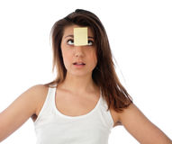 Surprised woman with note on her forehead Royalty Free Stock Photography