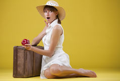 Surprised woman with old suitcase Stock Photos