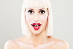 Surprised Woman with Open Mouth. Blondie Model with Makeup Stock Photos