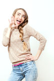Surprised Woman with open Mouth. Woman in stylish fashion clothes to makeup and hairstyle in studio on white background. Bright po. Surprised Woman with open Royalty Free Stock Images