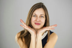 Surprised woman with opened mouth and big eyes holding hands the Stock Photos