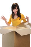Surprised Woman Opening Box stock photos