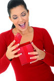Surprised Woman Opening Gift. Happy young woman surprised open red box gift. isolated on white stock photos