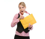 Surprised woman opening letter Stock Photo