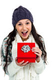 Surprised woman opening red gift box Royalty Free Stock Photography