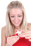 Surprised woman opening red present Royalty Free Stock Image