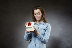Surprised woman opening souvenir Stock Images