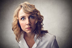 Surprised woman. Woman opening wide her blue eyes Stock Photos