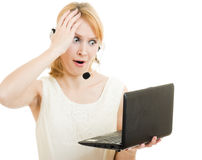 Surprised woman operator with a laptop Stock Photo