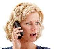 Surprised woman on the phone Stock Photos
