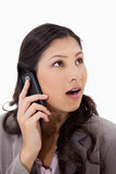 Surprised woman on the phone Royalty Free Stock Image