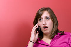 Surprised Woman on the Phone Stock Photo