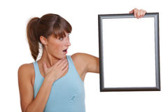 Surprised woman with picture frame Royalty Free Stock Photography