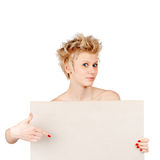 Surprised woman pointing on board Royalty Free Stock Photos