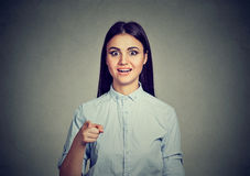 Surprised woman pointing finger looking at camera in astonishment Stock Photo